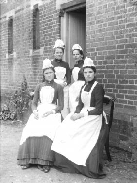 Four domestic maids (b/w photo)