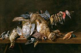 Still life of dead birds and a hare on a table