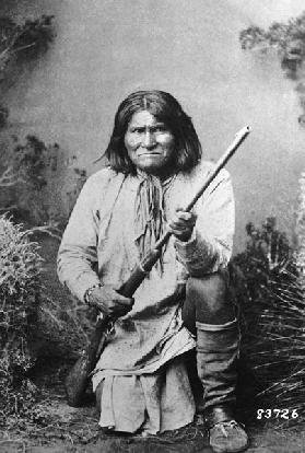 Geronimo holding a rifle, 1884 (b/w photo)