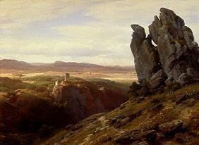 Low mountain range landscape with ruins of a castl