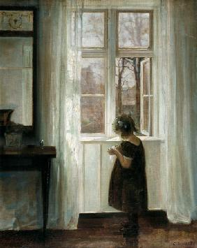 Little girl at a window
