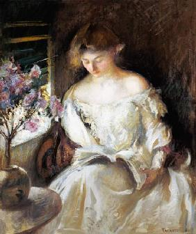 Reading young woman.
