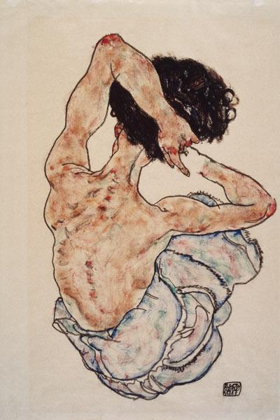 Woman with clasped hands, back view.
