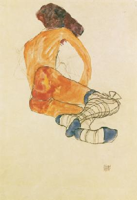 Sedentary female act with a blue stocking ribbon,
