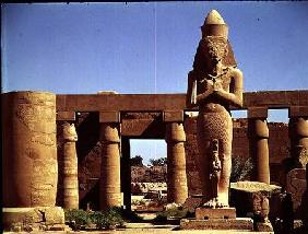 The Colossus of Ramesses II: standing statue of the king with his daughter Benta anta in front of hi