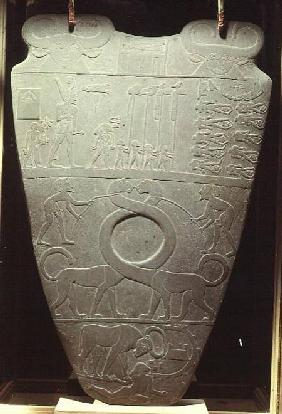 The Narmer Palette: ceremonial palette depicting King Narmer, wearing the red crown of Lower Egypt,