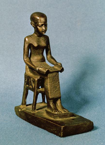 Seated statue of Imhotep (fl.c.2980 BC) holding an open papyrus scroll, Late Period