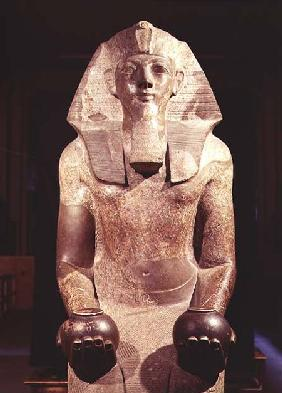Statue of Queen Makare Hatshepsut (1503-1482 BC) holding two vases containing offerings of wine and