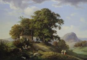 Mountainous landscape with cluster of trees and ch