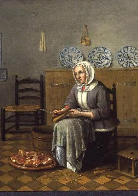 A Seated Woman preparing Food in a Kitchen