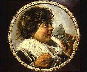 Half-length portrait of a laughing boy with a wine
