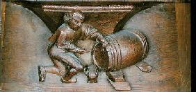 Carving depicting a man putting a tap on a barrel, from a choir stall from the Abbey of St. Lucien i
