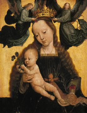 The virgin with the child is crowned by angels.
