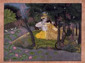 Radha and Krishna embrace in a grove of flowering trees