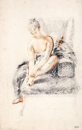 Semi-nude woman seated on a chaise longue, holding her foot (sanguine and black chalk on paper)