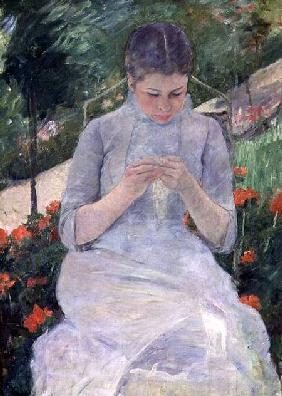 Young Woman Sewing in the garden