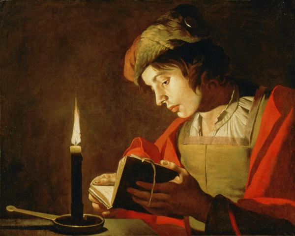Young Man Reading by Candle Light