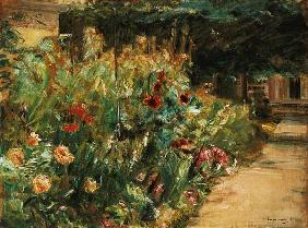 Flowerbed in the garden of the artist at the when