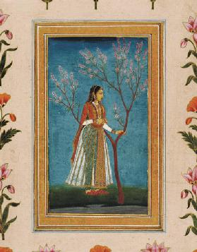 Lady standing by a tree in blossom, from the Small Clive Album