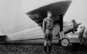 Charles Lindbergh American aviator in front of his plane Spirit of Saint Louis taking off from Roose