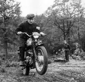 French Singer Ricet Barrier on a moto