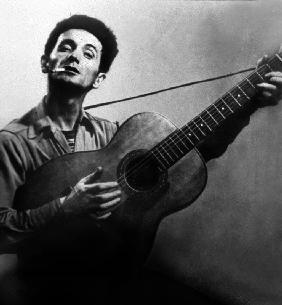 Musician Woody Guthrie considered as the father of folk music