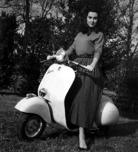 Paola Mori on a Vespa during her honeymoon with OrsonWelles in south of France