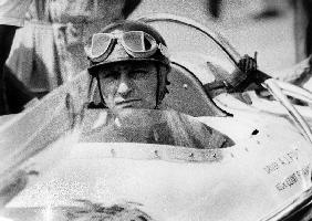racing driver Fangio here at the wheel during race in Monza