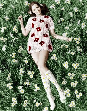 Young model Biddy Lampard in the grass wearing a short dress inspired by Courreges colourized docume