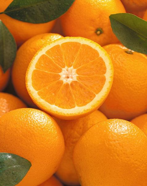 Oranges and cut orange, 1996 (colour photo)