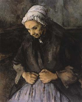Old woman with rosary.