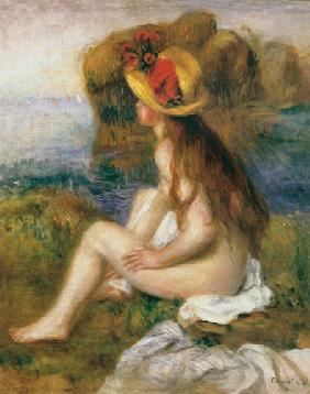 Seated female bather in a straw hat