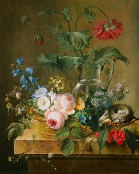 Roses, anemones in a glass vase, other flowers, cherries and bird's nest